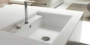 how to clean yellow stains from white acrylick kitcgen sink