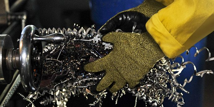 DPS Kevlar(R) Worker Handling Metal Shavings