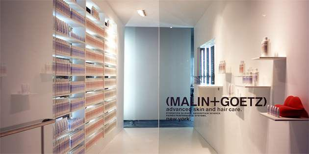 Modern entryway at MALIN+GOETZ features DuPont™ Corian® solid surface in practic