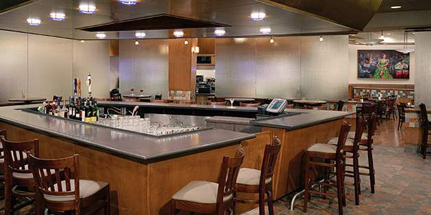 Varona's modern restaurant and bar design utilizes Corian® solid surface to crea