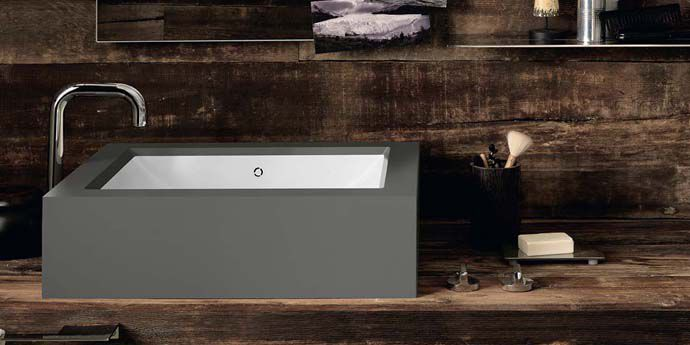 The Corian® Refresh washbasin smoothly set into Corian® in the industrial grey Deep Cloud shade