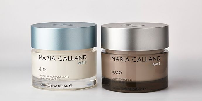 "Maria Galland Cosmetic Cream Jars made with DuPont™ Surlyn® (pictured on left: ""Soil Silhouette"" and on right, ""Ligne Mille"""