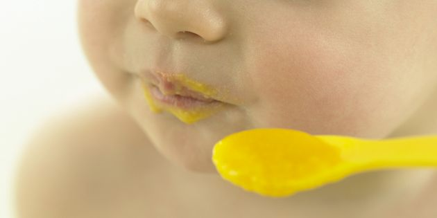 Baby eating baby food.