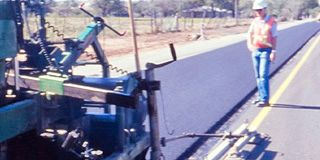 How Does Polymer Modified Asphalt Made with Elvaloy® RET Work (machine paving road shown)