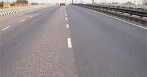 Side-by-side comparison of paving materials on India's GVK Expressway